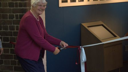 Jean Hook, who has been volunteering with CANS for over 20 years, cutting the ribbon for the exhibit