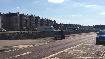 Trvallers have pritched up on Weston's Beach Lawns. Picture Lily Newton-Browne