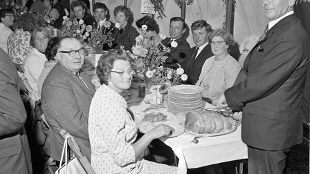 Mr. Stanley Hutchings at one of the many crowded tables at Hewish Harvest Home. Picture: WESTO