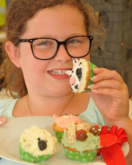 Evie-Mae Collings displays her decorated animal cupcakes.Picture: Jeremy Long