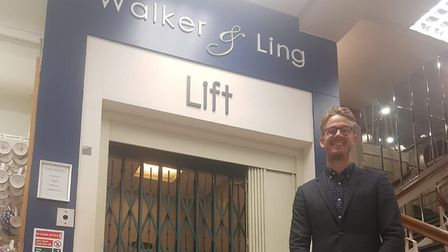Sam Walker, the owner of Walker and Ling stood by the first electric passenger lift in Weston
