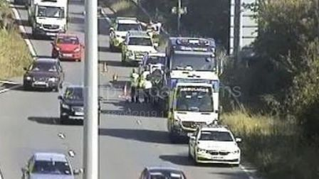 Police on the scene of Junction 21 incident. Picture: Highways England