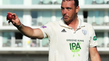 Hampshire's Kyle Abbott points the ball towards the crowd as he leaves the field, after taking seven
