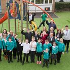 Staff and KS 1&2 pupils at Westhaven School, celebrating as school is in the top six of most improve