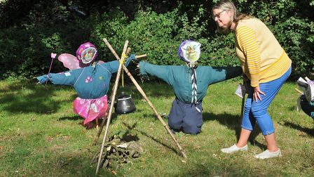 Sue Castle looking at a scouts scarecrowUphill Scarecrow Festival. (V)22,09,19