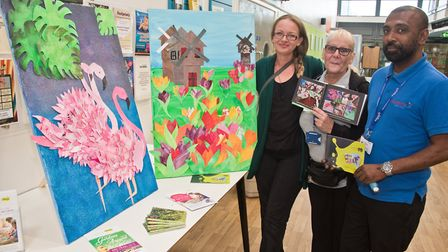 Organiser Mel Tyas-Peterson with carehome staff looking at some of the artwork created for the art t