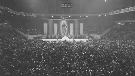 US flags, swastikas and a portrait of George Washington at a meeting of the German American Bund hel
