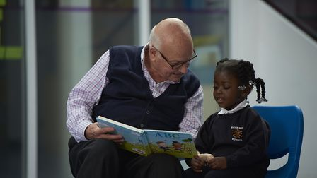 Reading volunteers are trained to help children develop their confidence and skills.