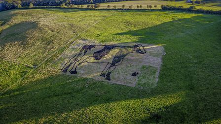 The giant cow created from cow pats.