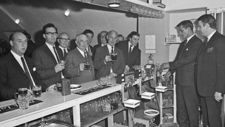 Mr. C.W.E. Buckle, sales manager for Bass-Charrington (South West) Ltd., pulls a pint at the opening