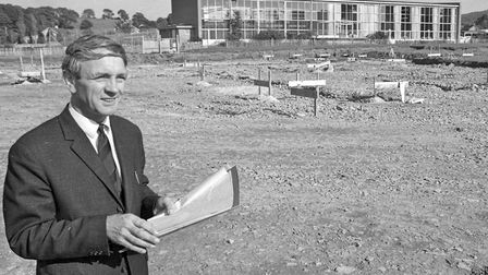 Mr. D. Foster, headmaster, studies the plans for Churchill School - the first comprehensive school i