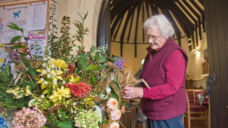 Shelia Inglis with one of the displays at Flower festival at St Barnabus Church flower festival.