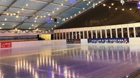 The festively-lit ice rink.