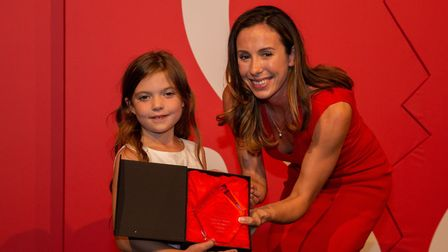 Isabelle receiving her award from the British Heart Foundation.