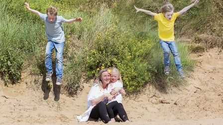 Lucinda Holt with her mum Nikki and brothers Zack and Evan on Uphill beach.