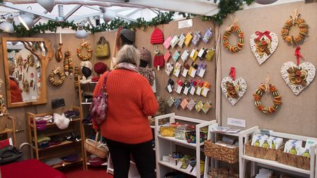 Visitors browsing Paul & Renate O'Donnell Xmas crafts showcase at Claverham. Picture: MARK ATH
