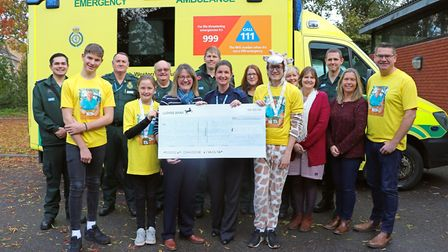 Ceri Walsh handing over the money she raised to the South Western Ambulance Service NHS Foundation T