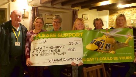 Organisers of Bleadon Country Show donating money to Dorset and Somerset Air Ambulance.