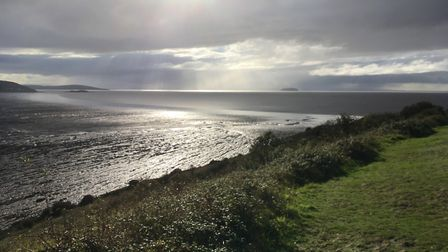 Clouds roll over Sand Bay on a sunny afternoon.Picture: Mike Jerrett