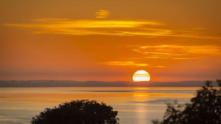 An orange glow surrounds Portishead during sunset.Picture: Alan Harrison