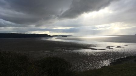Sun breaks through thick clouds near Sand Bay.Picture: Mike Jerrett