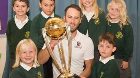 Hutton Primary school pupils with the cricket world cup being held by Scott Chappell from the Somers