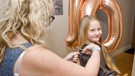 Ava's hair getting the snip from hair stylist Emma Hill. Picture: MARK ATHERTON