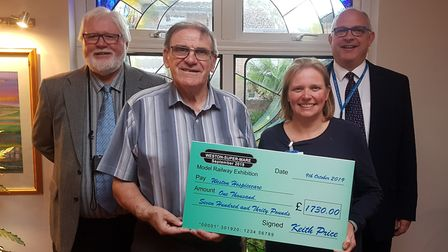 Keith Price and show colleague John Parkhouse present the proceeds of Keith's latest event to Weston