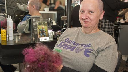 Sally Daly shaving her hair, for Macmillan Cancer Support 'Brave the Shave' in memory of her son, Da