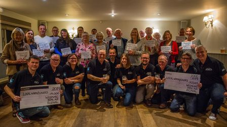 Local charities receiving cheque from the Wedmore Real Ale Festival