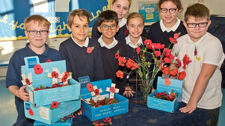 Year six pupils from Christ Church Primary School who will be taking poppies and collection boxes ar