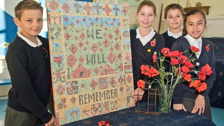 Year six pupils from Christ Church Primary School with a mosaic they have made to present to Somerse