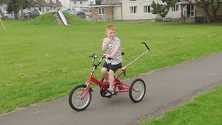 Jacob testing out his new trike.