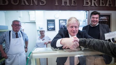 Prime Minister Boris Johnson behind the counter at Burns the Bread bakery, during a walkabout, in th
