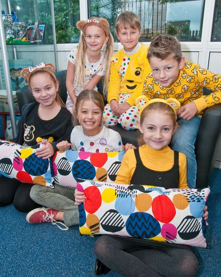 Milton Park Primary School pupils in spotty clothes and having a cake sale for Children in Need.