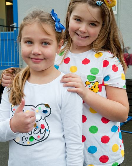 Uphill Primary School Morning Move, pupils doing dance moves in spotty clothes for Children in Need.