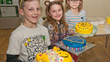 Children in Need Bake-off competition judges with the prize winning cakes at Court de Wyck Primary S