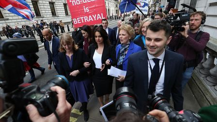 Former Labour MPs Chuka Umunna (second left) and Luciana Berger (third left) with Conservative MPs H