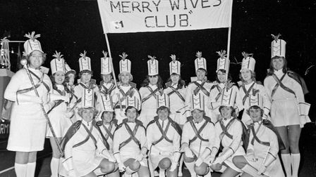 In red and white, the majorettes of Bournville Merry Wifes' Club won first prize for a local feature
