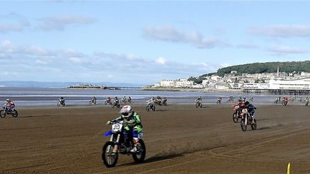 Riders seamlessly glide along sand in the race for first place at Weston Beach Race.Picture: Terry K