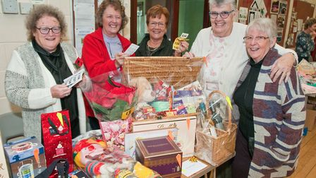 Parishioners and helpers around the raffle prizes at Kewstoke Church Crafts for Christmas event.