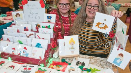 Helen Lowe and Grace Pryce-Jones with handmade greeting cards at Kewstoke Church Crafts for Christma
