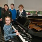 Ajudicator John Byrne and Nailsea Town chairman Cllr Jan Barber with compedititors in the piano clas