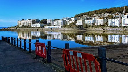Homes reflected in Westons seawaters. Picture: Derek Hitchins