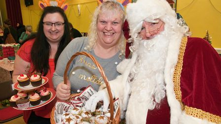 Caron Newell and Elaine Borthwick tempt Santa with their home made cakes at St Georges Christmas fet