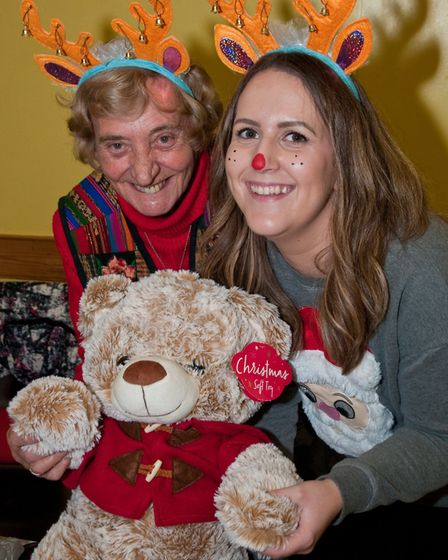 Guessing the name of the Teddy with June Williams and Amy Walsh at St Georges Christmas fete. Pic