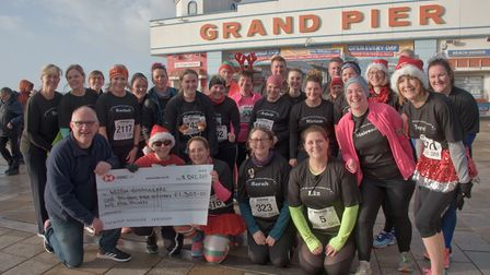 First time runners cheque presentation to Mark Flower from Weston Hospicecare. Picture: MARK AT