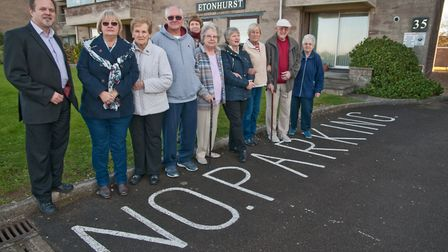 Cllr Robert Payne with residents of Etonhurst flats who have petitioned council to improving parking