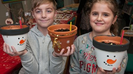 Josh and Bethany with Christmas bulbs in pots at Hutton School Christmas Fete. Picture: MARK ATHE