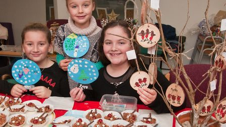 Pupils Erica, Hallie and Beatrice selling cakes and crafts at Hutton School Christmas Fete. Pictu